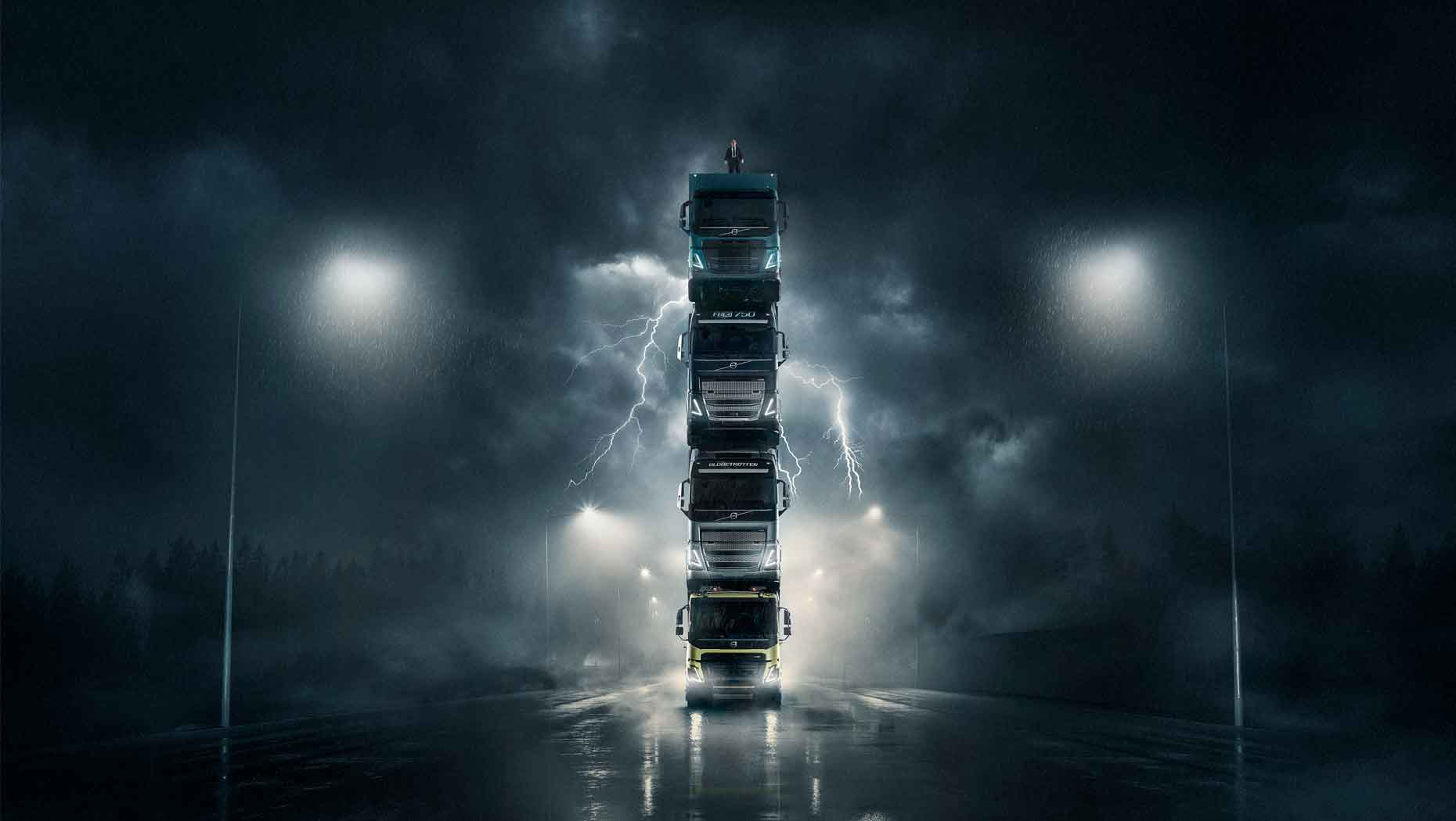 The new Volvo FMX, FH, FH16 and FM trucks stacked on top of each other in a spectacular tower.