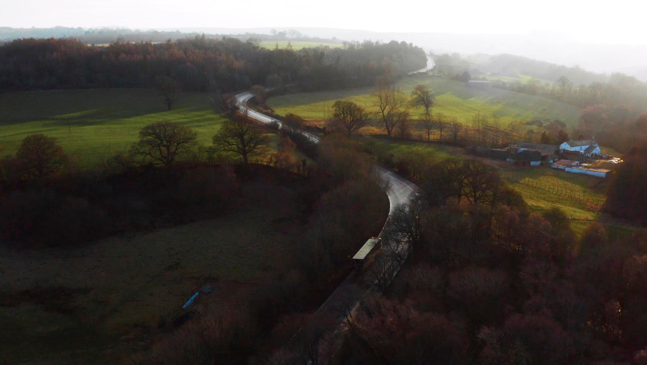 An aerial view of a road cutting through the countryside in northern England